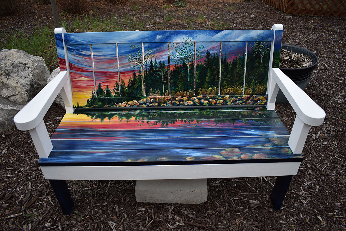 Bench with sunset scene painted in Sturgeon Bay, Door County.