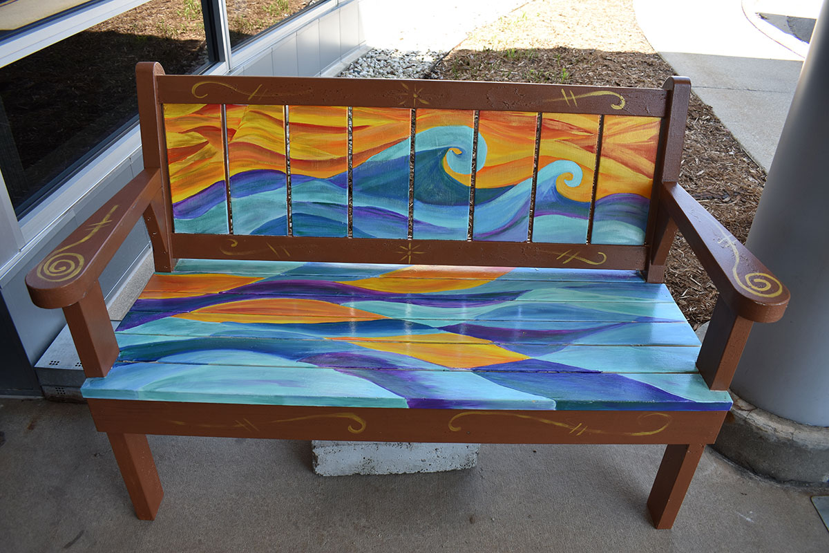 Bench with painted wave pattern in Sturgeon Bay, Door County.