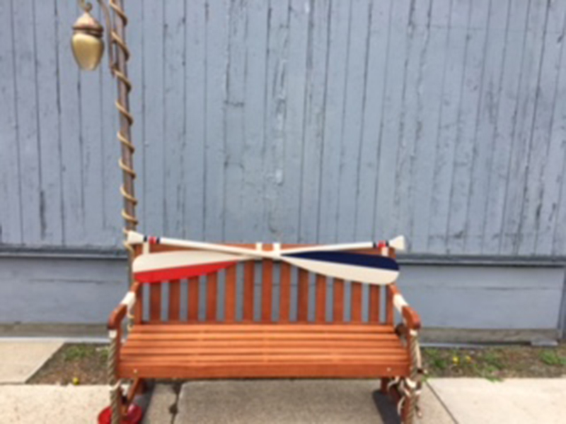 Bench decorated with a ship theme, including oars, in Sturgeon Bay, Door County.