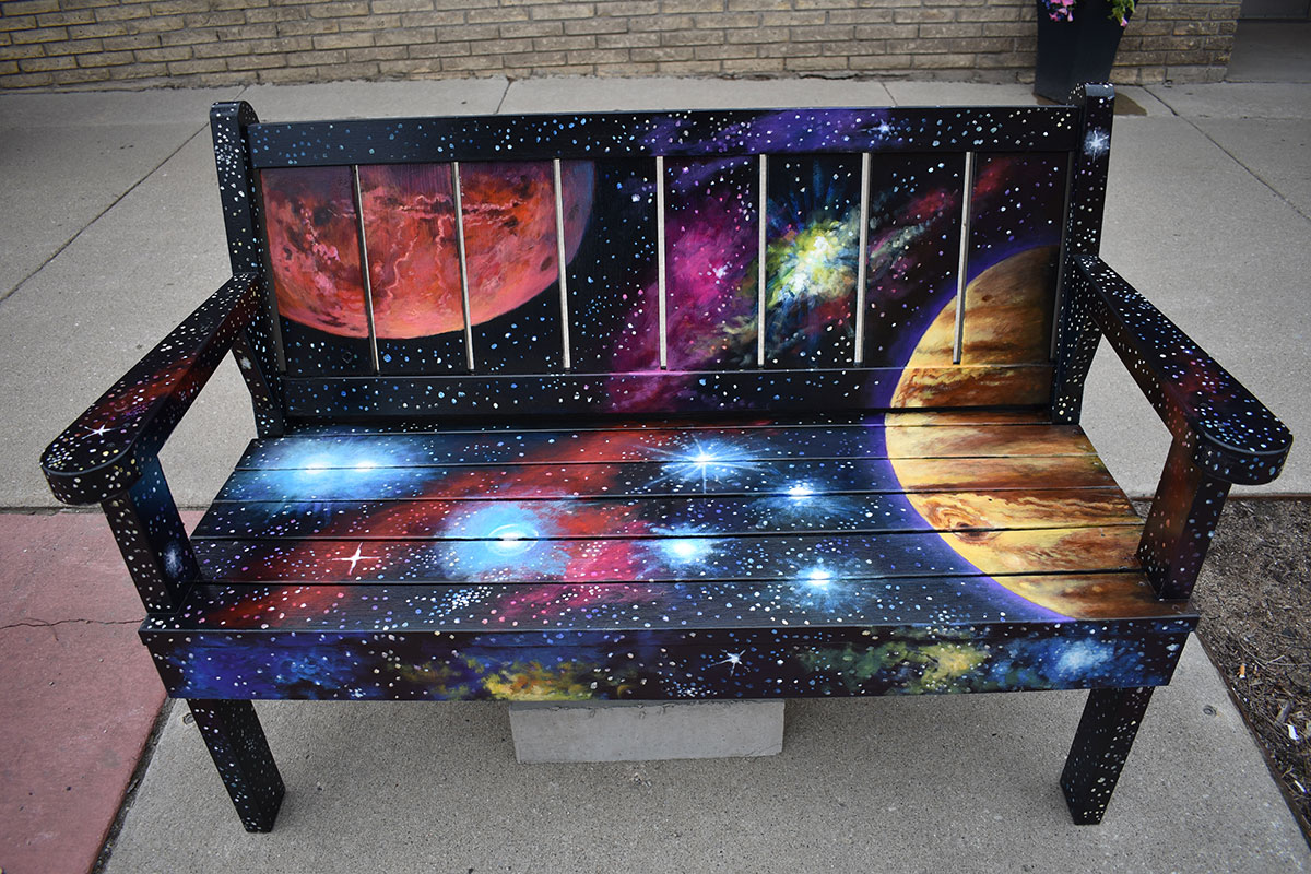 Bench decorated with solar system, stars, planets.
