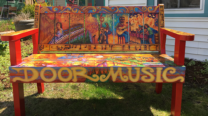 Bench painted with musical scenes, including musicians & instruments, in Sturgeon Bay, Door County.