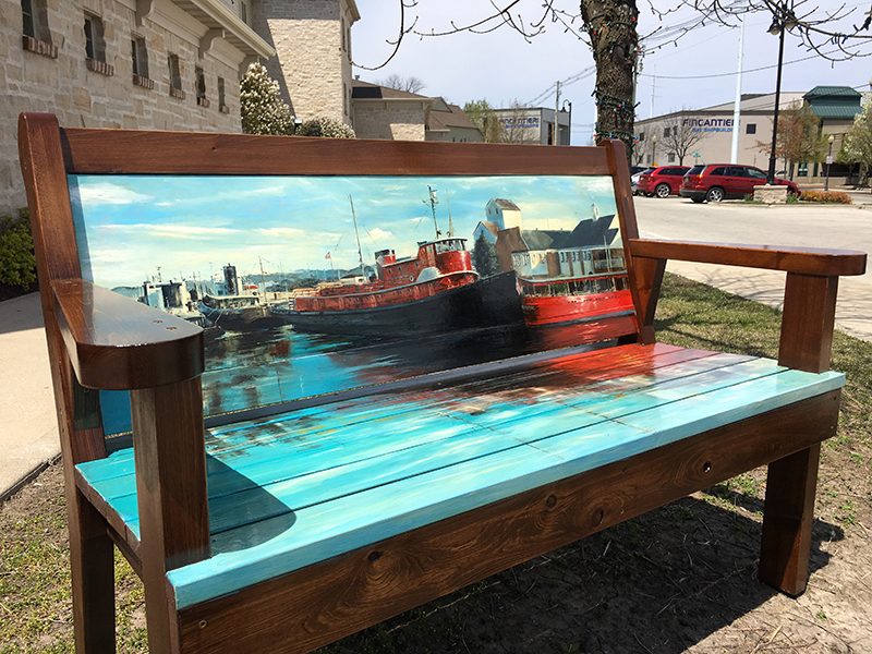 Bench painted with ships in the dock in Sturgeon Bay, Door County.