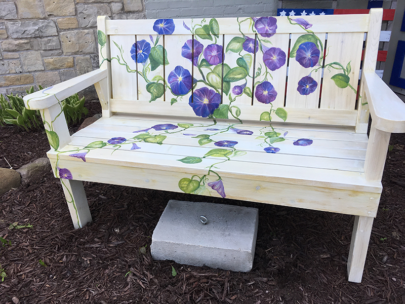 Bench painted white with purple flowers in Sturgeon Bay, Door County.