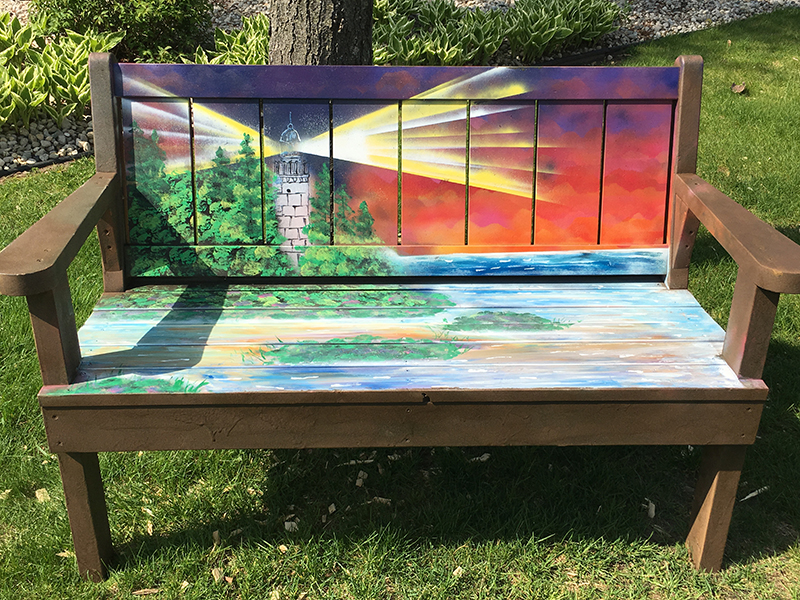 Bench painted with a lighthouse scene in Sturgeon Bay, Door County.