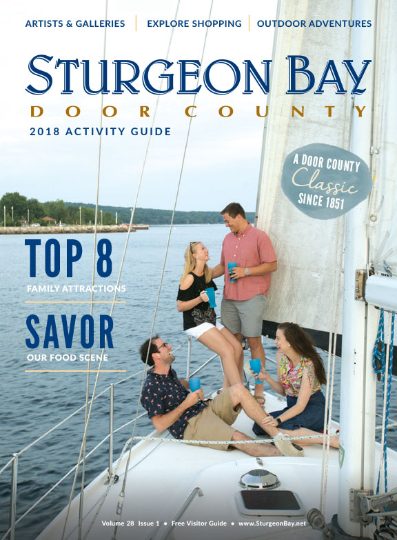 Cover of 2018 Sturgeon Bay Activity Guide, image of people on a sailboat