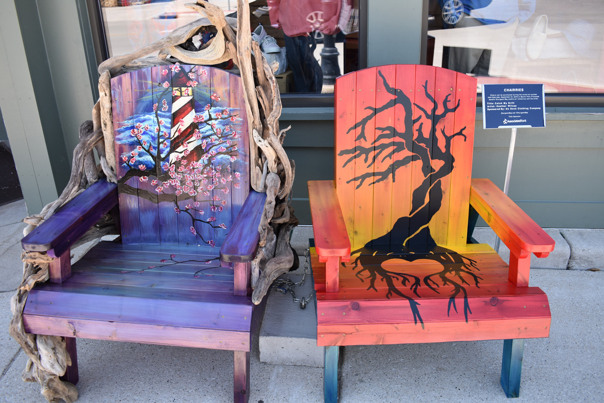 pair of adirondack chairs with hand painted lighthouse and tree silhouette