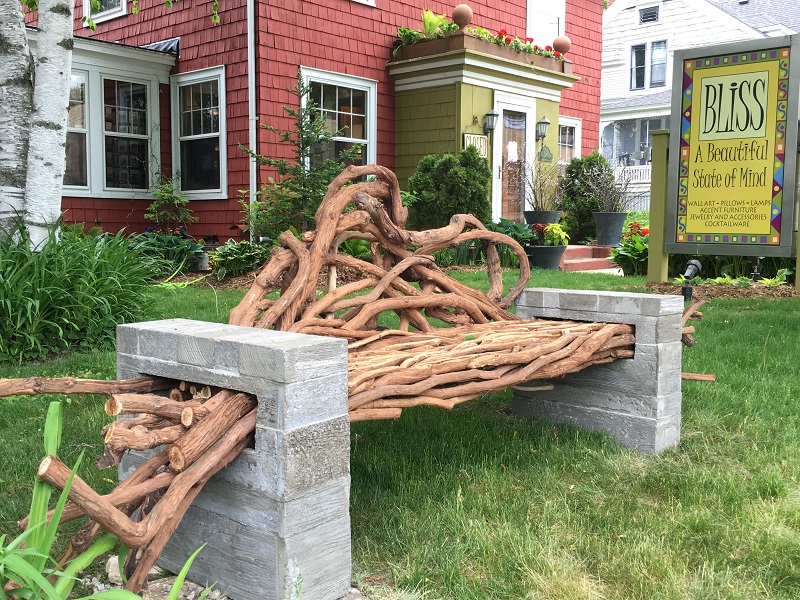 Bench with block sides and the bench seat made from branches in Sturgeon Bay, Door County.