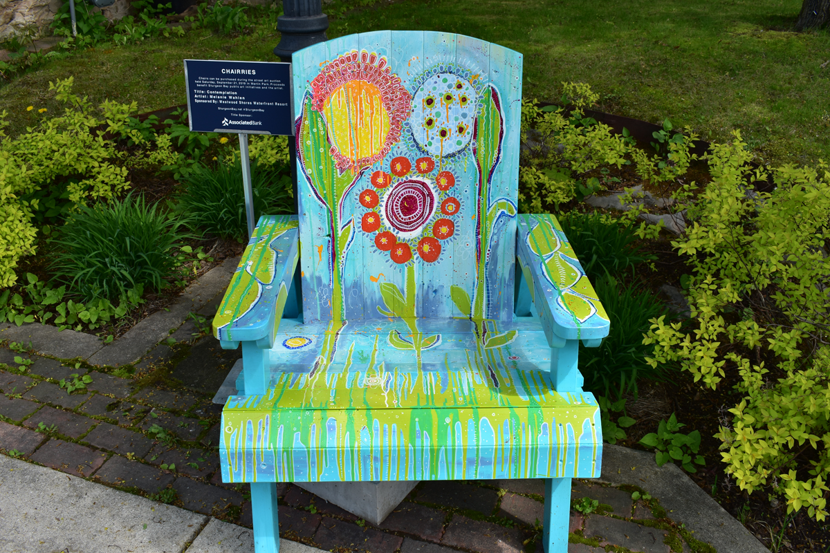 hand painted floral design on adirondack chair