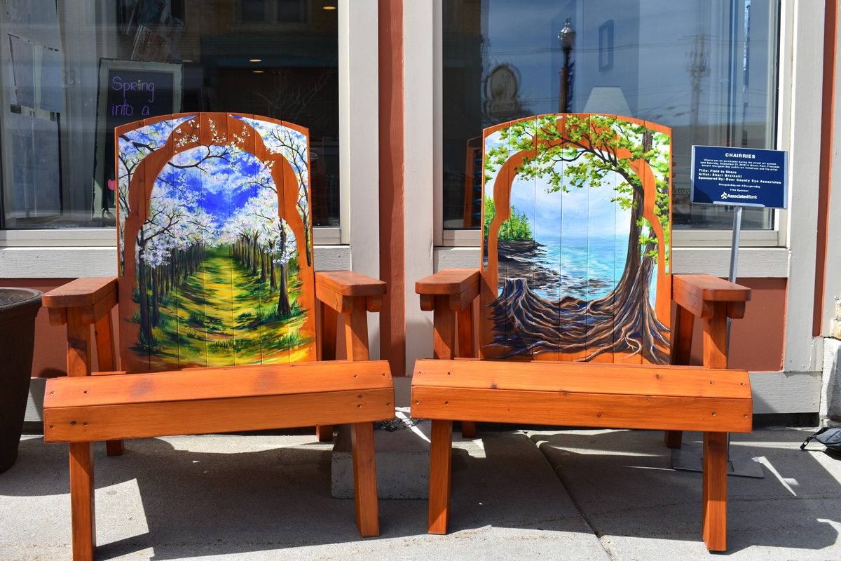 pair of adirondack chairs with hand painted Door County scenes