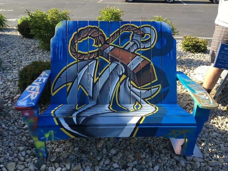 Blue bench with an anchor painted on it in Sturgeon Bay, Door County.