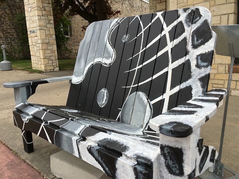 Bench painted with black, gray and white art in Sturgeon Bay, Door County.