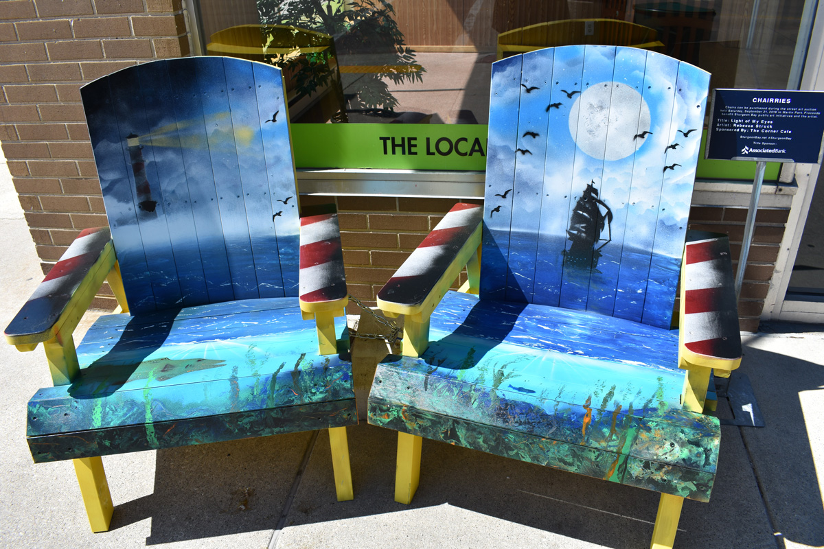 pair of adirondack chairs with hand painted Door County water scenes
