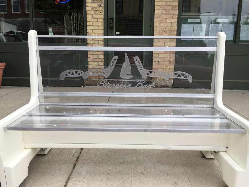 Glass bench with the Steel Bridge etched into the back in Sturgeon Bay, Door County.
