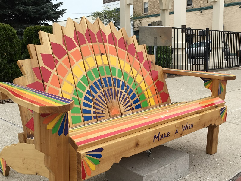Rainbow colored Make A Wish bench in Sturgeon Bay, Door County.