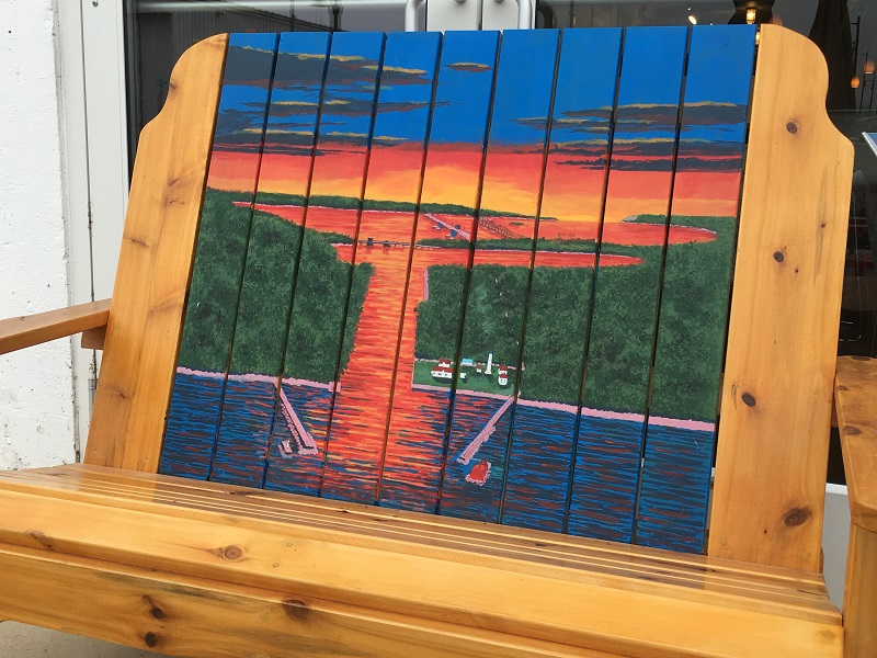 Bench displaying a painting of Sturgeon Bay in Sturgeon Bay, Door County.