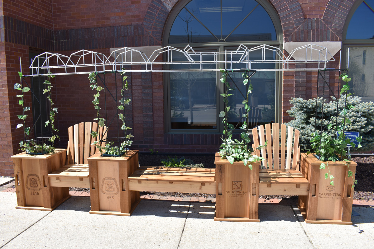 adirondack chairs with hand crafted trellis depicting Michigan Street Bridge
