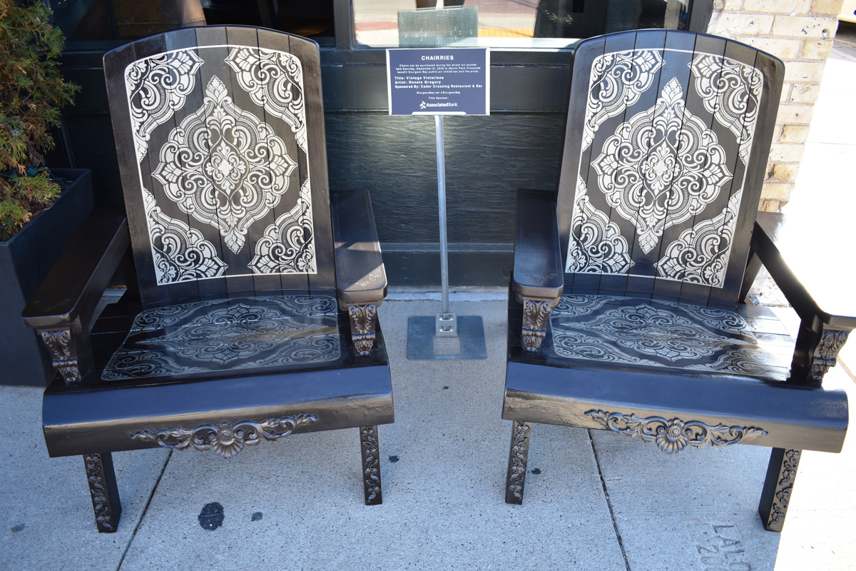 pair of adirondack chairs decorated in a Victorian style
